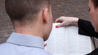 over shoulder reading bible