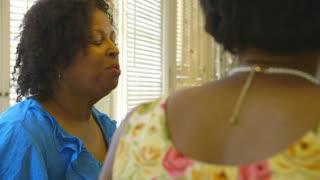 over shoulder shot of woman talking.
