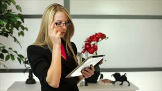 pacing businesswoman with tablet