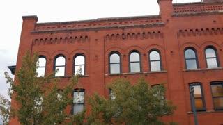 pan across red brick building establishing shot.