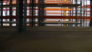 pan around a large empty warehouse 4k.