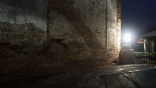 pan from an old brick wall to a glass roof of an underground cistern 4k