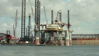 pan oil platform following barge.