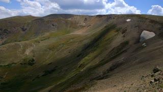 pan to valley below a ridge line