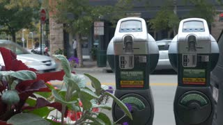 parking meters on a busy street 4k.