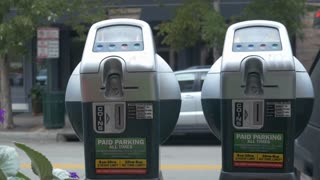 parking meters on a busy street.