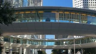 passing a modern circular crosswalk in downtown Houston