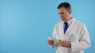 pharmacist looks at camera