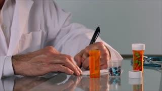 pharmacist pouring pills into bottle