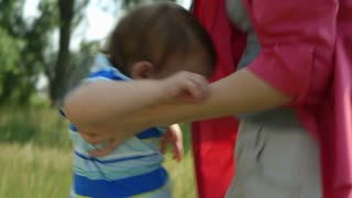 playing with the baby in a park.
