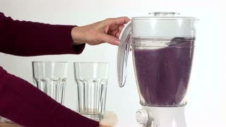 pouring a fruit smoothie