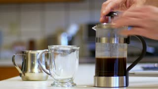 pouring coffee in a mug 4K.