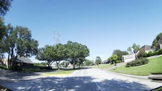 pov fisheye view of driving though a typical suburban street 4k