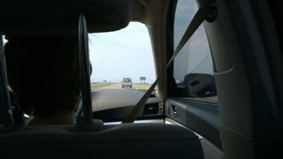 POV from back seat while driving.