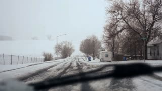 POV of driving in the snow