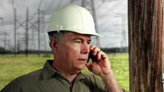 Power grid repairman on the phone.