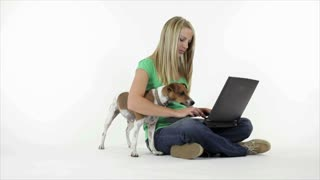 Pretty girl and her dog with laptop