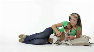 pretty girl listening to music with her dog