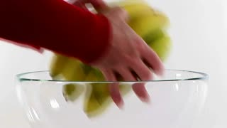 putting fruit in a bowl