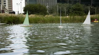 radio controlled sailboats in an urban park downtown houston texas 4k