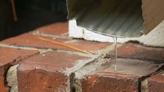 rain water coming down a spout from a residential house
