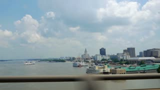 View of downtown Baton Rouge Louisiana as seen from bridge that crosses the Mississippi river.