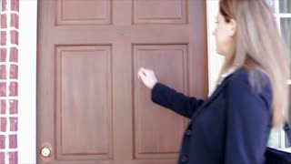 Saleswoman being greeted at clients door.