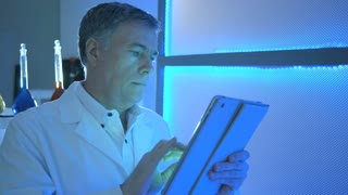 scientist looking at a tablet pc