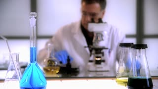 scientist working focus on foreground