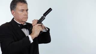 secret agent point gun at camera