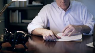 shallow DOF of businessman working on a document 4k