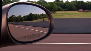 side mirror view of driving