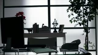 silhouette businessman working at desk