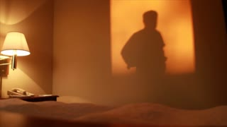 Silhouette man in hotel room