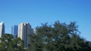 slow motion driving past modern highrise buildings