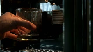 slow motion filling a water glass