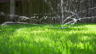 slow motion water sprinkler on a lawn.