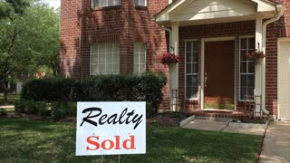 sold sign on house