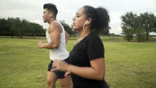 steadicam of two people jogging getting winded 4k