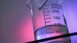 stirring liquid in a beaker