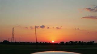 sun setting highway drive.