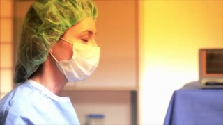 Surgeon talking to another doctor