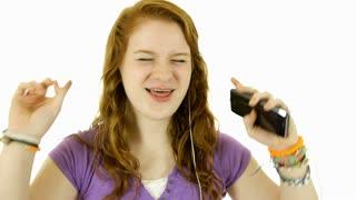 teenage girl having fun listening to music