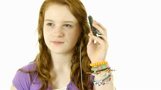 teenage girl isolated on white listening to music.