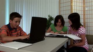 teenagers studying at home