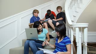 teenagers studying on stairs