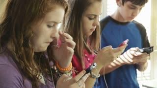 teenagers using smart phones