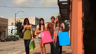 teens shopping in an outdoor mall