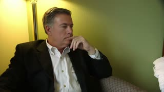Thinking businessman in a hotel room.