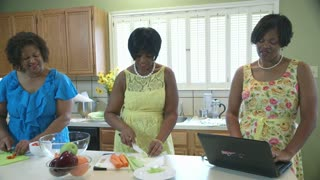 three african american women in a kitchen